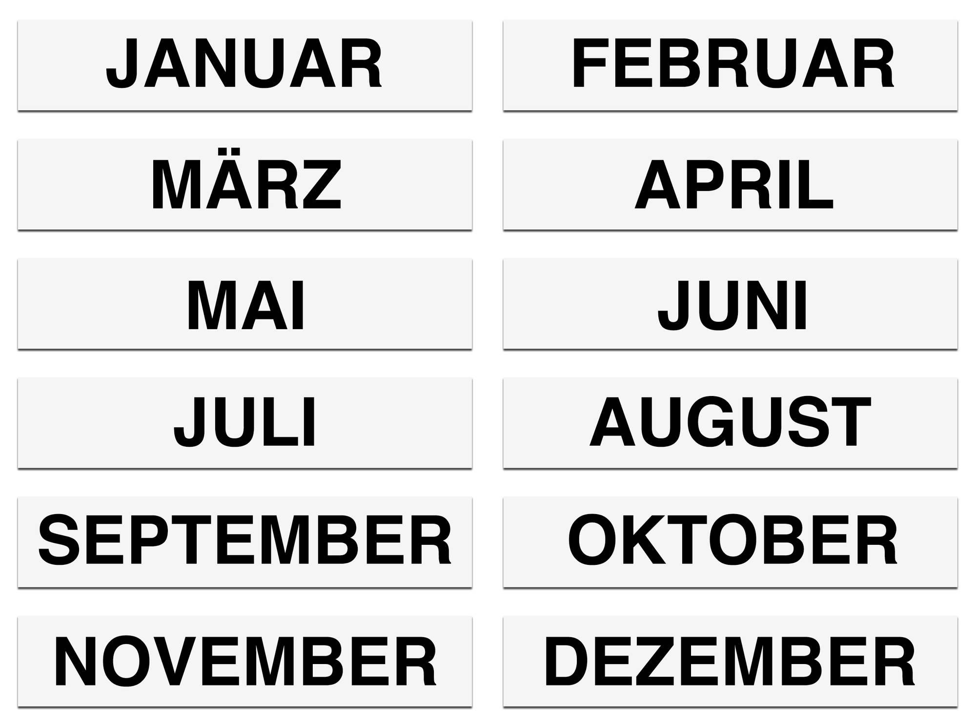 Schwarz bedruckte Monatsmagnete Januar bis Dezember mit den Maßen 100 x 20 mm